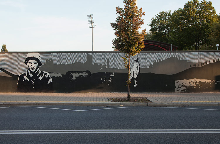 Warsaw Uprising by anonymous artist (2017) Unveiled on the eve of the 73rd anniversary of the Warsaw Uprising, this 250-meter work is one of many to commemorate the insurgency that led to the destruction of the city, but is unique for being the only thing related to Polonia Warsaw football club that escapes vandalism from Legia fans. The location is not incidental: the stadium behind was the scene of heavy fighting.  ul. Konwiktorska 6