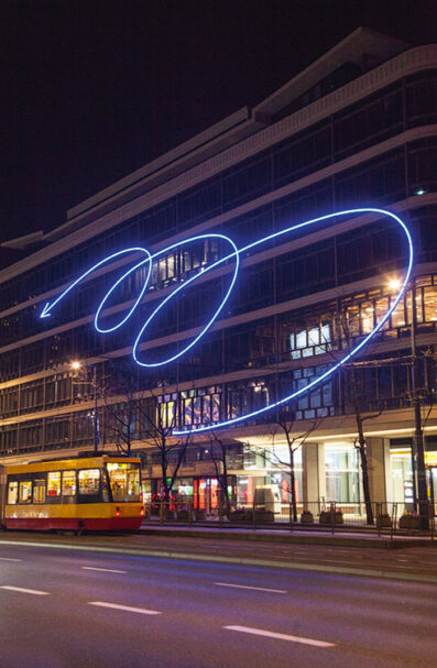 CeDeT (Bracka / Jerozolimskie)  Designed and produced in East Germany as 'an expression of gratitude' after the Germans were given use of the first floor to sell their consumer goods, the original serpentine neon that once adorned the CeDeT building was lost in a suspicious blaze that roared through the building in 1975. Now it's back, with an identical, 4.5 ton replica built in close cooperation with the city's Monument Conservation Office. First added in 1951, five years after the building originally opened, the return of the structure's swirly, blue neon sign has won widespread praise from members of the public.
