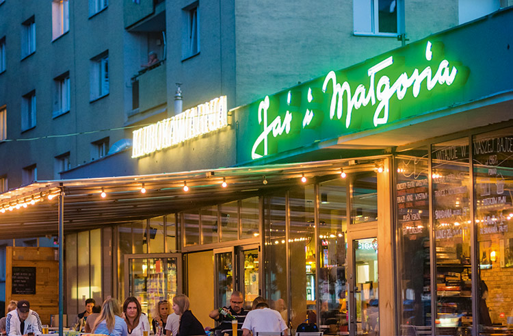 "Jaś & Małgosia (Al. Jana Pawła II 57) It's this sign that kick-started Warsaw's modern love of neon. Returned to its spiritual home in 2014 (above an old commie bar that itself had relaunched in a more modern guise), courtesy of a crowdfunding campaign organized by David Hill and Ilona Karwinska, the pair were so taken aback by the response that it galvanized them to create the city's Neon Museum. ""We saw how attached people were to neon,"" says Hill, ""and how desperate they were for it to return. If nothing else, it was a magnificent public outpouring of affection."""